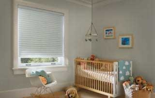 cellular roller shades in a nursery