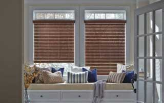 faux wood blinds in a window nook