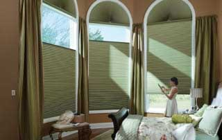 motorized shades in a bedroom
