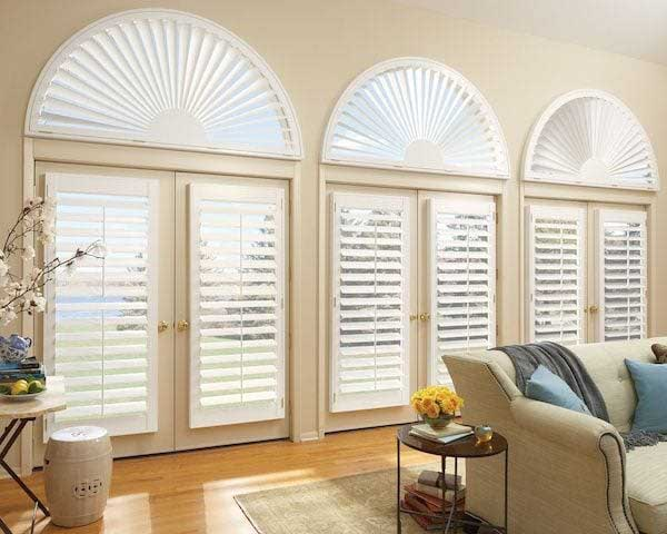 Shutters on french doors and arched windows