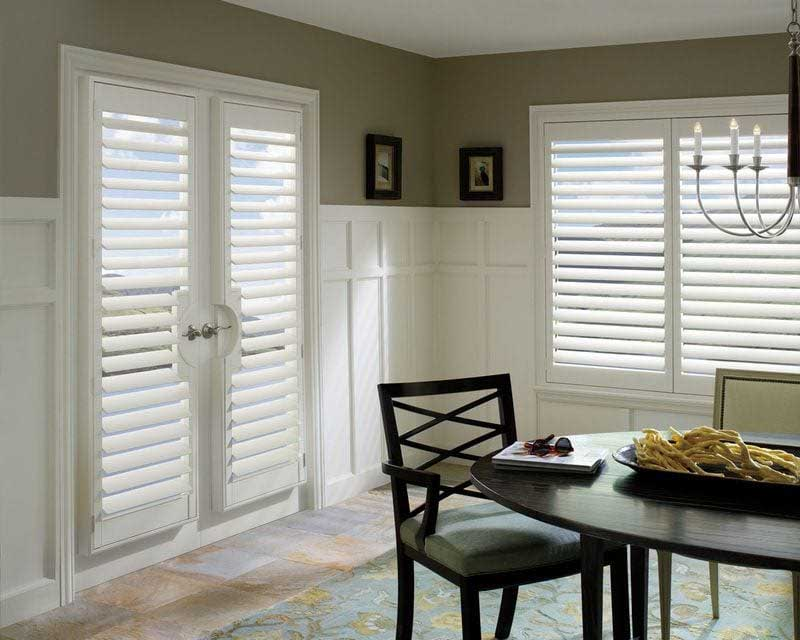 White shutters on french doors and window